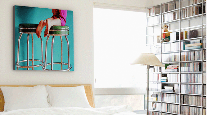 Canvas prints are printed on canvas surfaces with inks that last for generations, giving them a durable time span. Find your treasured digital photos and transform them into personalized wall art to hang in your space. In this image: the appearance of a canvas print hanging inside a room.